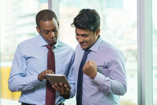excited-business-people-reading-good-news-tablet-computer-min (2)